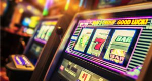 Who pays the jackpots for progressive machines?